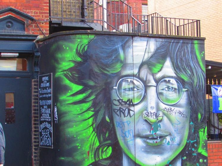 Graffiti art - green and dark blue image of John Lennon